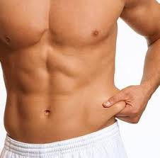 man pinching abs belly fat