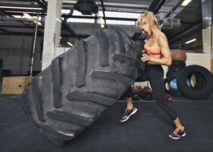 Crossfit women blond tire flip