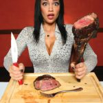 womaneatinghugesteak