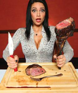 womaneatinghugesteak